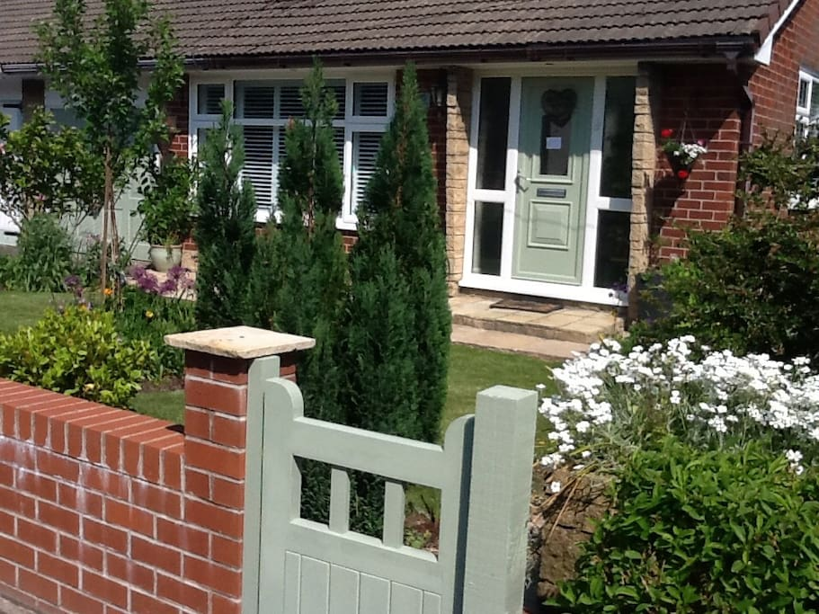 Bungalow frontage with drive and storage