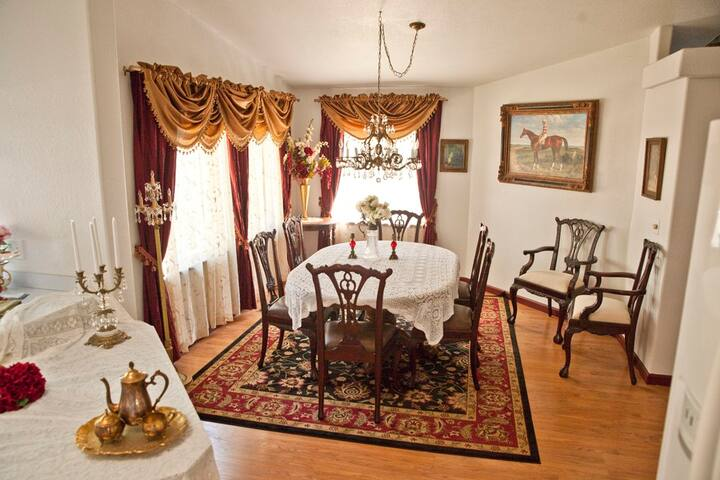 The dining room is just off the modern kitchen and features formal dining for 6 with additional seating for 2 available.