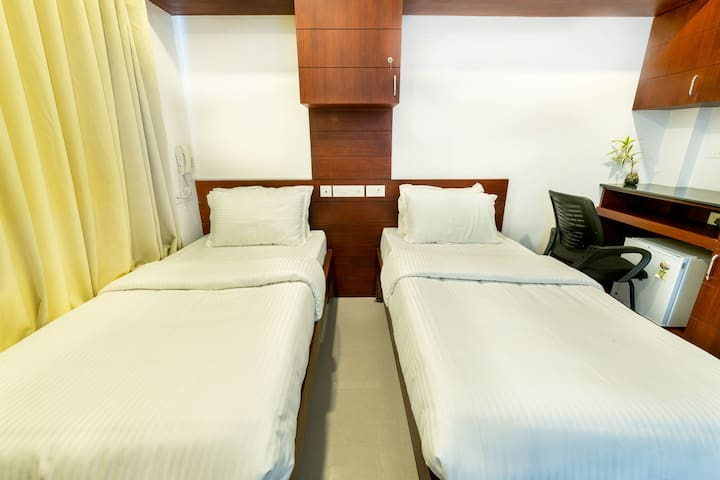Air Conditioned twin bed room near Amrita Hospital