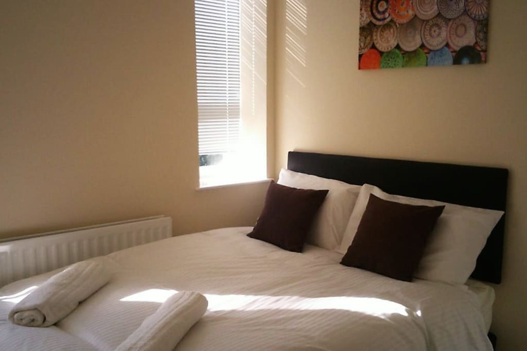 Bedroom 1 with a comfy double bed and wardrobe