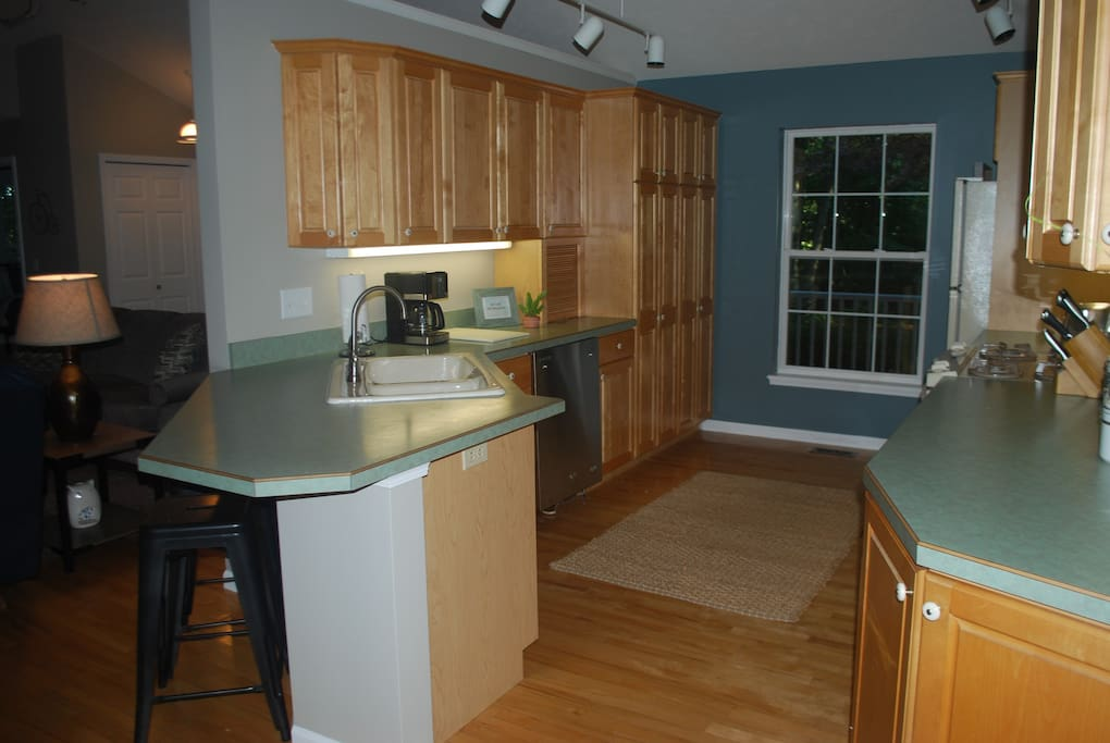 Large Kitchen open to living & dining rooms.
