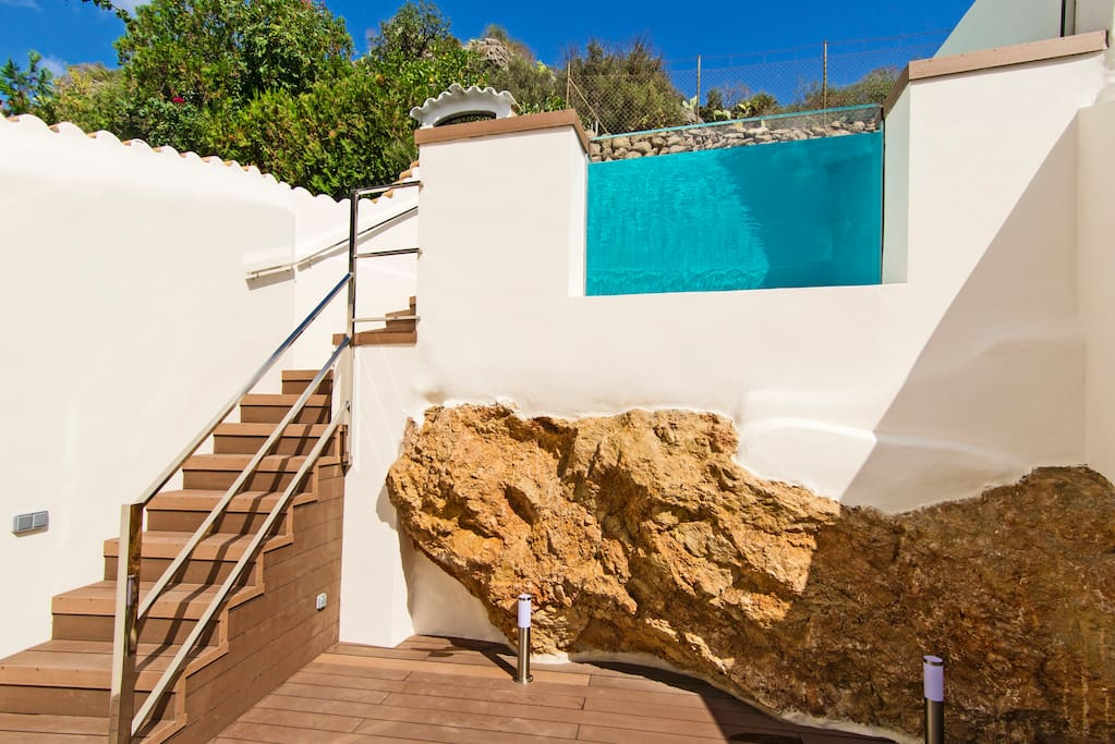 Glass fronted pool and sun deck below
