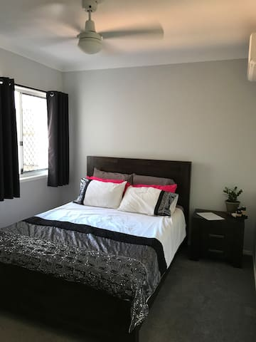 Air conditioned room with ensuite & parking.