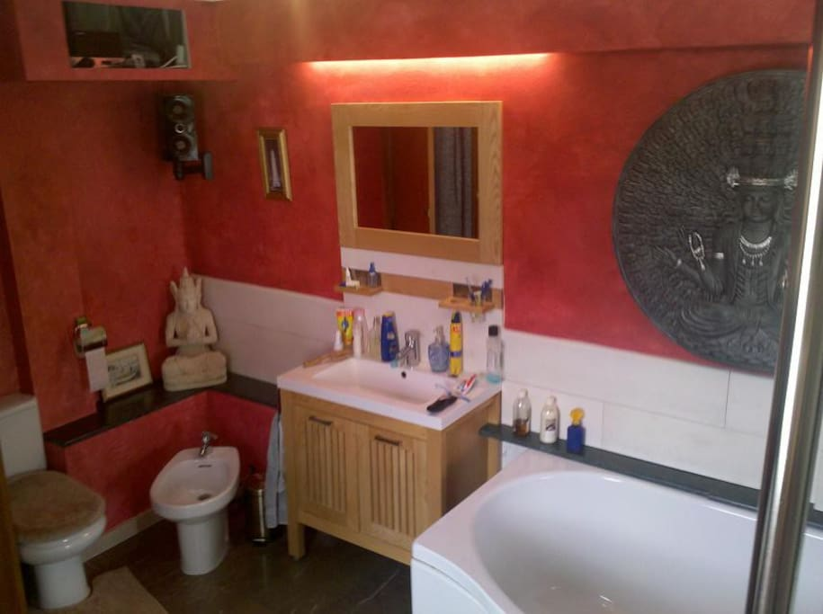 Main bathroom with large double bath, and music system.