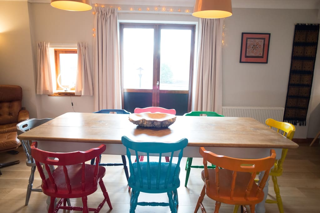 Dining table with double doors to south pacing patio
