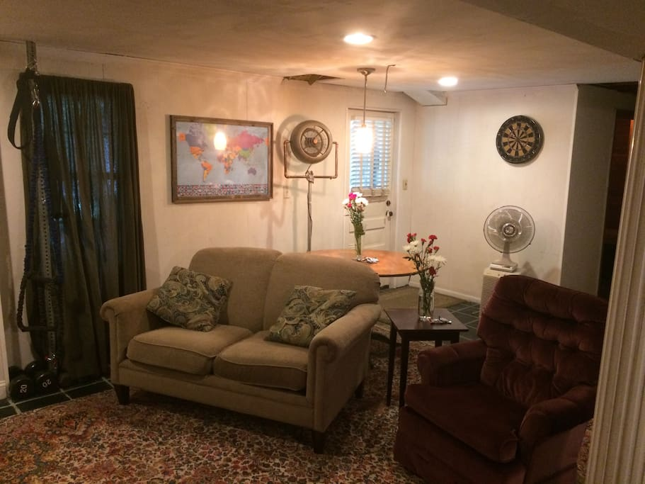 Comfortable living area with Large screen Television and/or top line work out equipment!