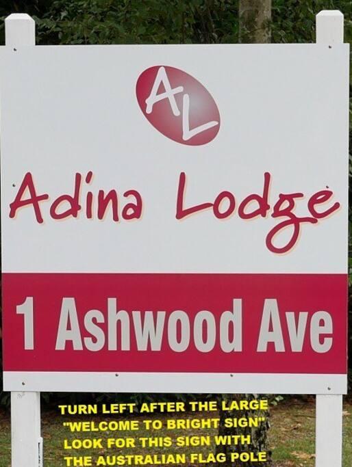 Entry sign to Adina Lodge