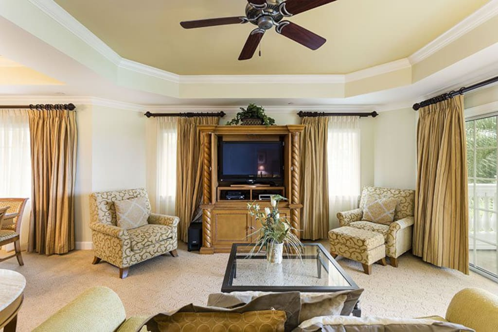 Sit and relax while watching a show on the flat screen TV