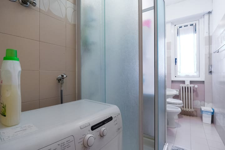 Bathroom is very clean and spacy. You can use the washing machine