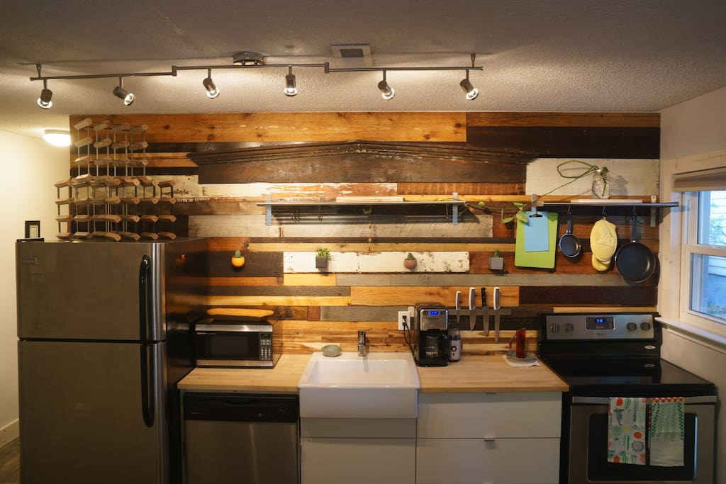 Kitchen has ample storage, great lighting, and an artist vibe.