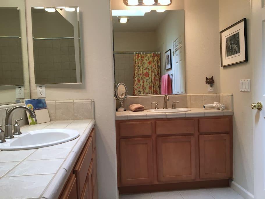 Shared full bath has 2 vanities with sinks