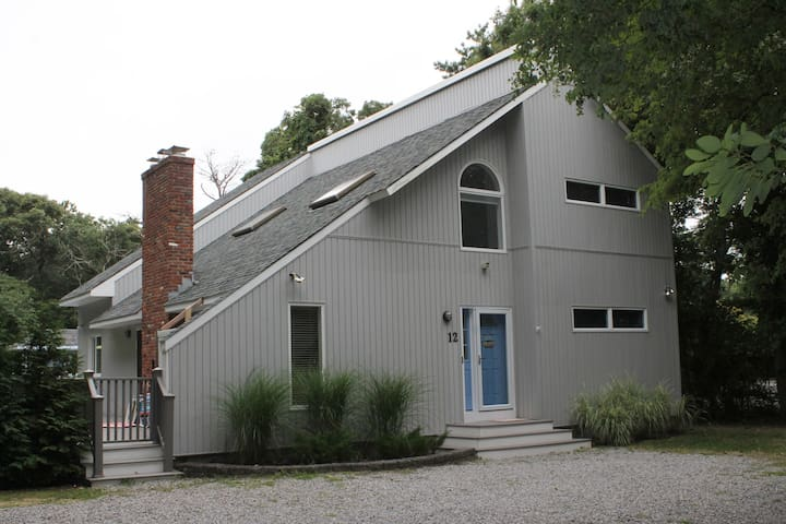 Front of the house. Large gravel driveway can accommodate up to six cars.