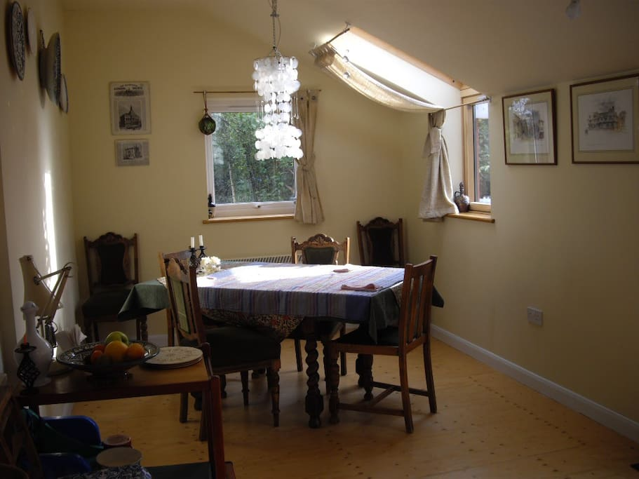 Light, airy, double aspect dining room with door to rear garden