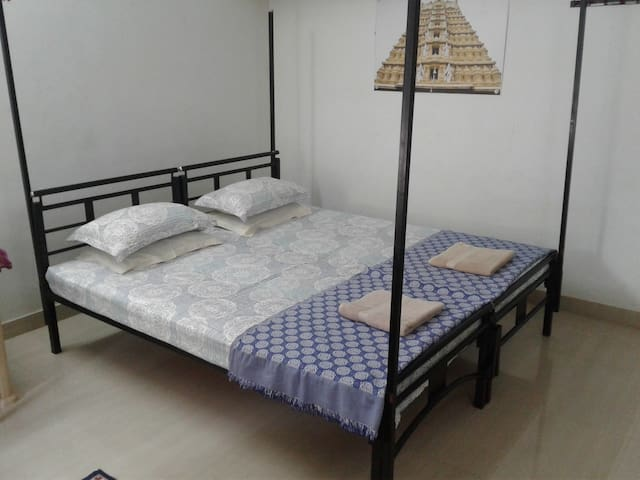 Double bed with mosquito net provision .