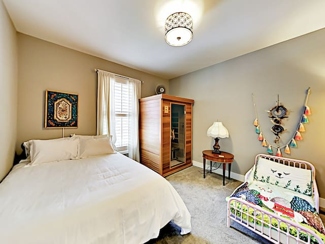 The 2nd bedroom features a queen-size bed, a twin-size bed, and a single-person sauna.