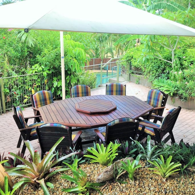 Large covered outdoor table seats eight