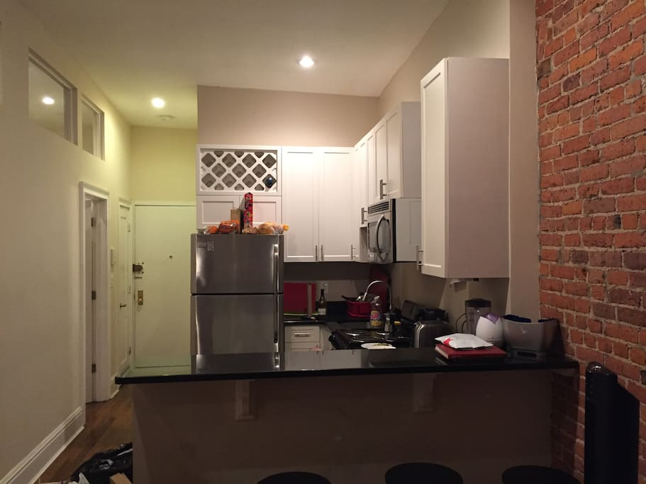 Kitchen -  stainless steel appliances including a dishwasher.