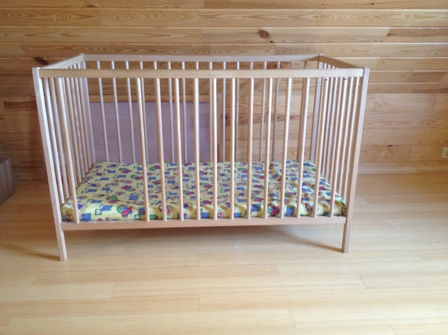 A baby cot for a child up to 3 years old.