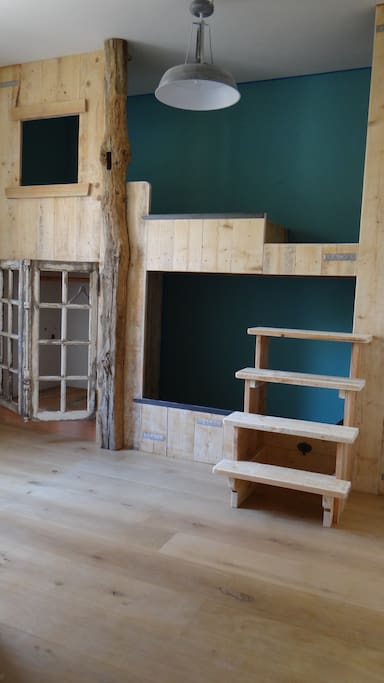 bunk beds in wood with adult size. For  2 persons, children.
