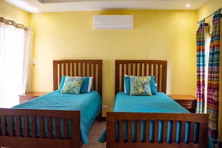 Third bedroom with two twin beds Beds can be made into a king bed