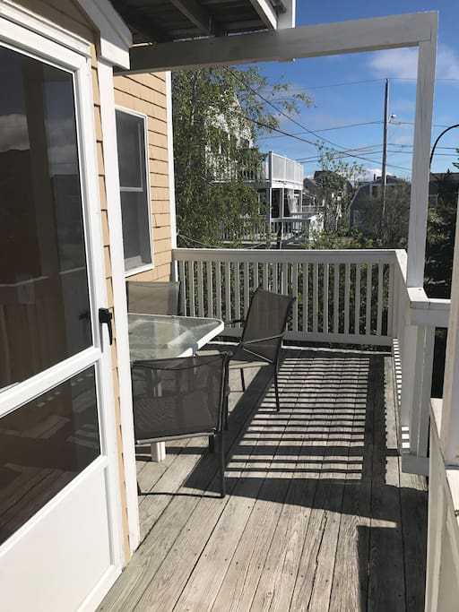 Back deck - perfect for al fresco meals and enjoying the spectacular sunset. Umbrella available.