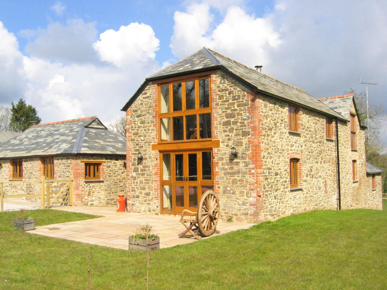 stunning stone eco barn with huge enclosed courtyard, garden and patio, private off road parking