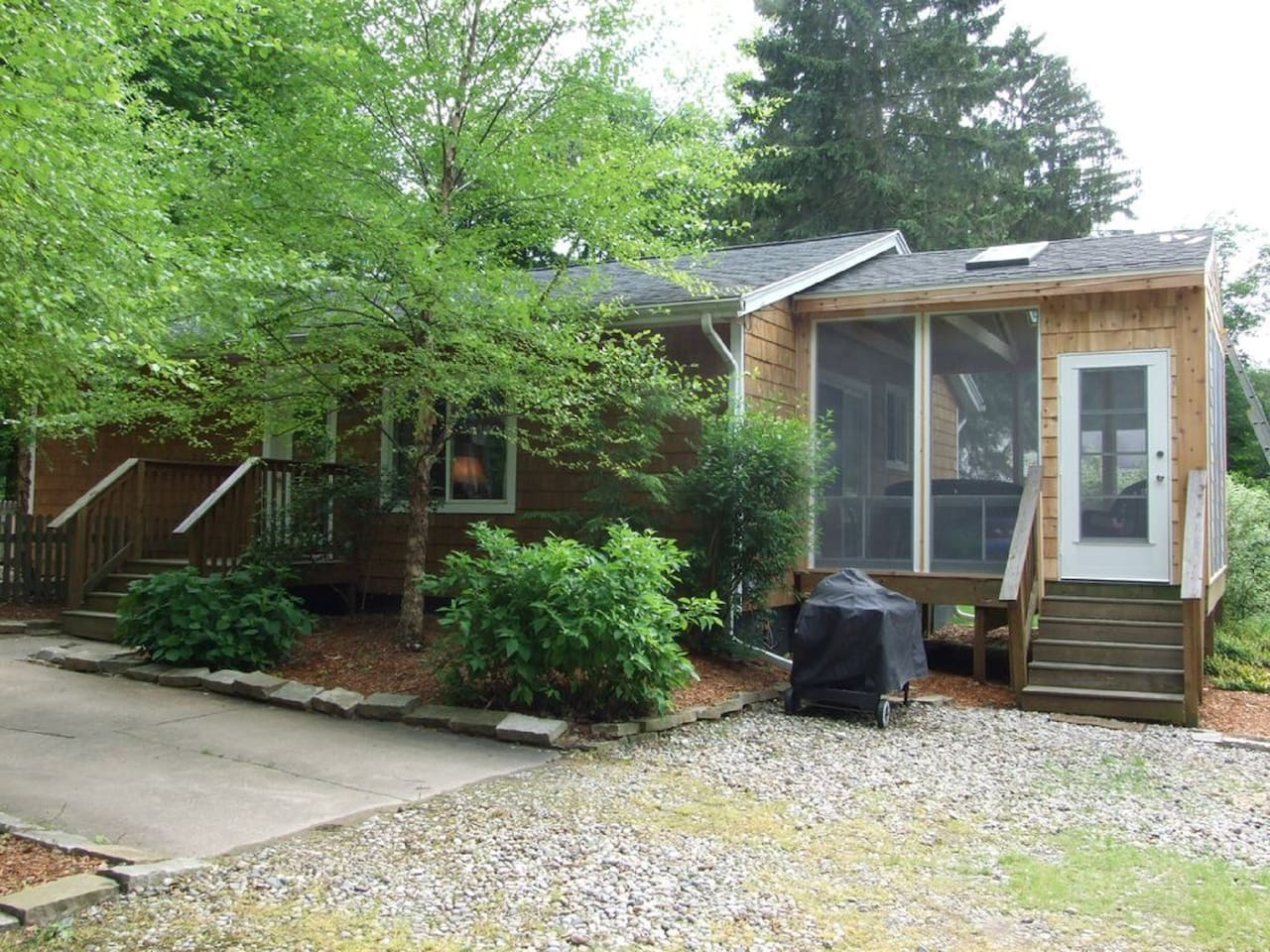 Lovely cedar shake cottage studio on a private wooded acre with large screen porch