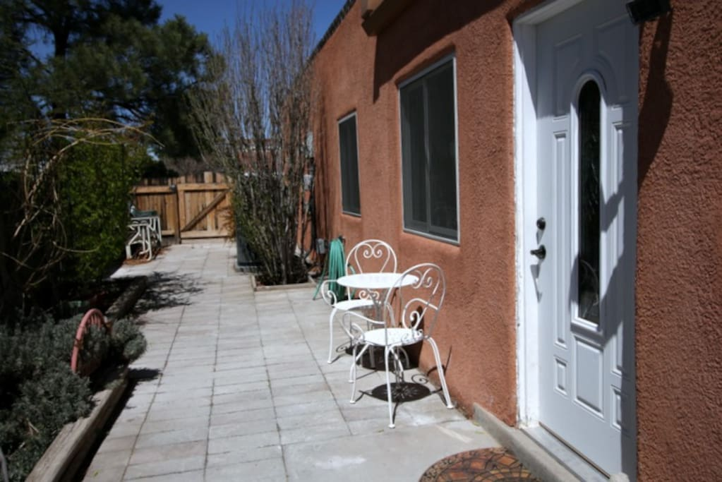 Private patio with separate entrance to the apartment