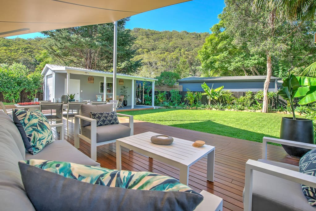 Unwind in the outdoor lounge area, with views up to Patonga Hill.