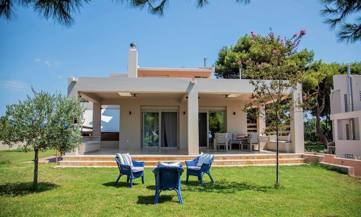 Seaside Sunset Villa with private garden