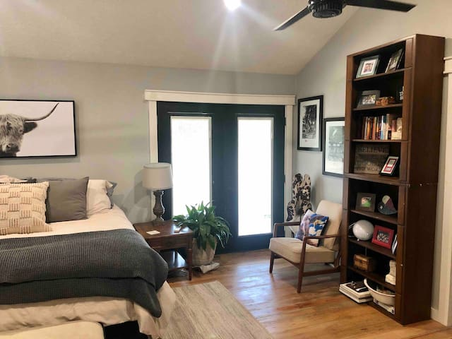 Bedroom equipped with king size bed, reading nook and French doors to back porch