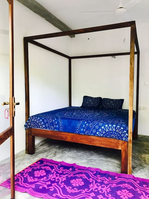 King size bed with fancy bedsheets