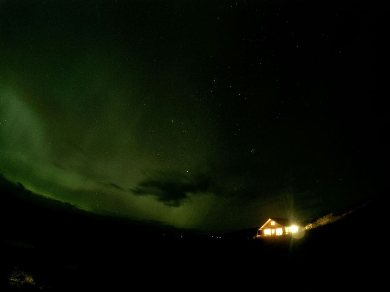 The Stundarfriđur 4  and the northern light taken by Daniel Gunz