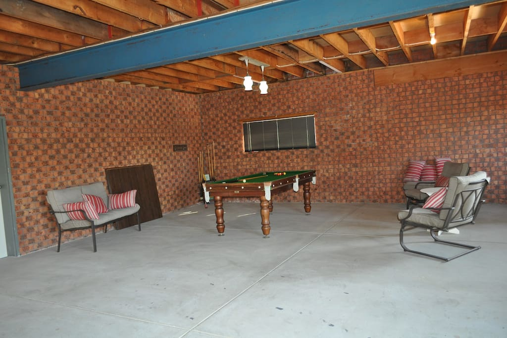 Large garage with pool table and dart board
