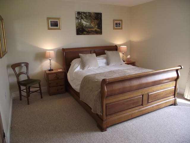Main bedroom with king size bed & freeview TV