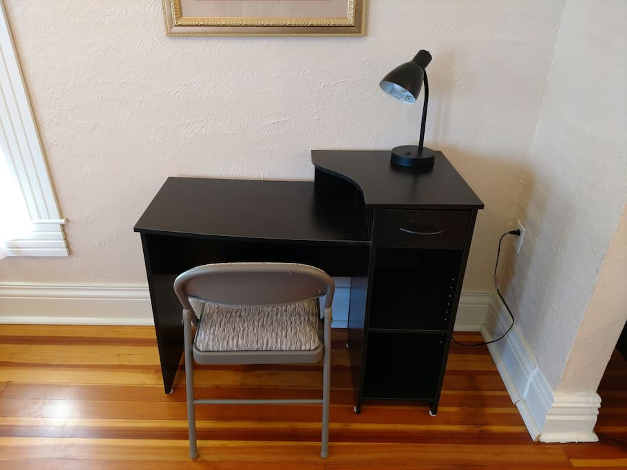 Work station with desk lamp and easy access to power