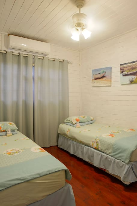 Bedroom furnished with 1 Double Bed or 2 Single Beds. Air Conditioned.