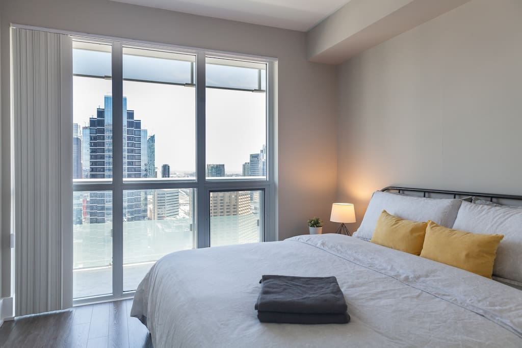 King Size bed in the Master bedroom overlooking the CN Tower