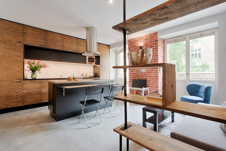 Elegant Industrial Studio Apartment by Tyzenhauz