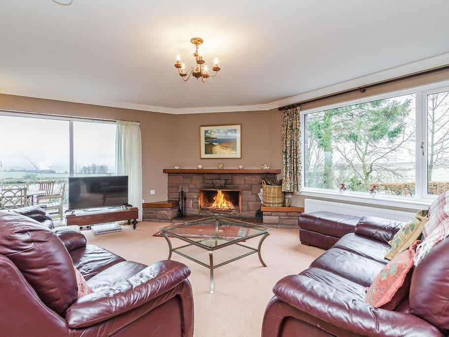 Comfortable and bright living room with wide-screen TV and DVD player