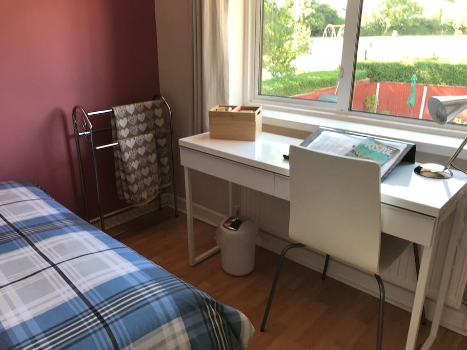 Towels, welcome pack, desk & chair. Bedroom overlooks a lovely garden and community park
