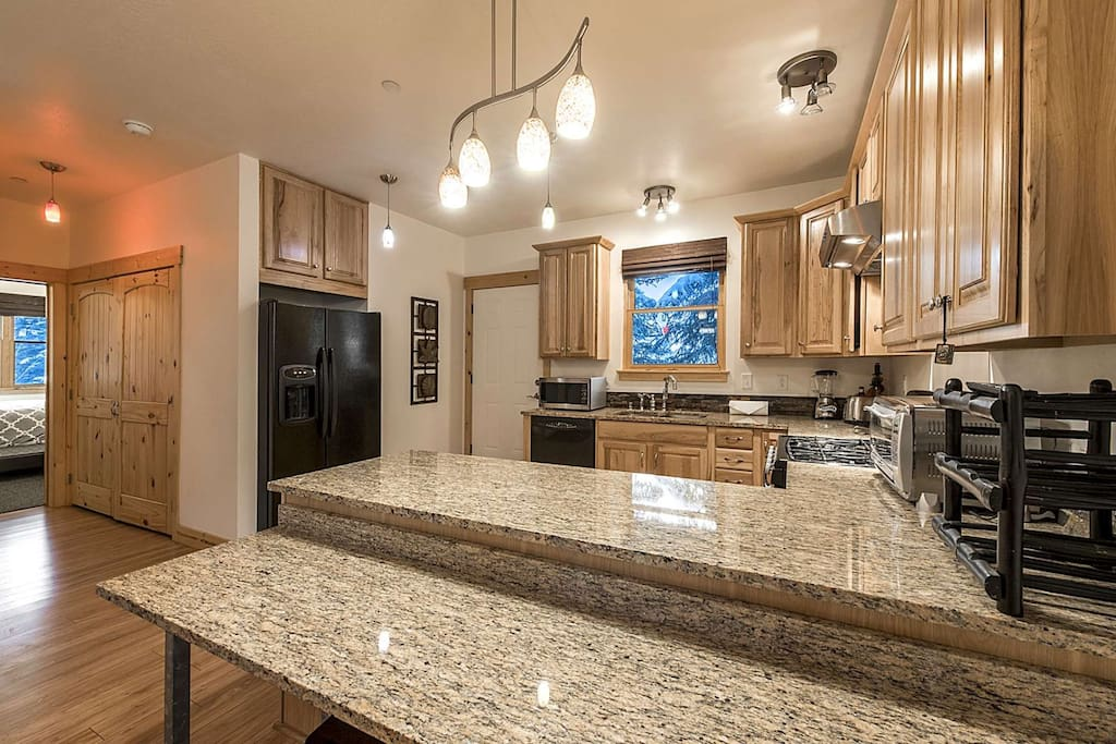 Situated just off the kitchen is a large laundry closet – complete with washing machine, clothes dryer and storage.