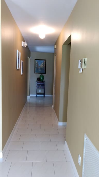 Hallway leading to den, kitchen and bedrooms