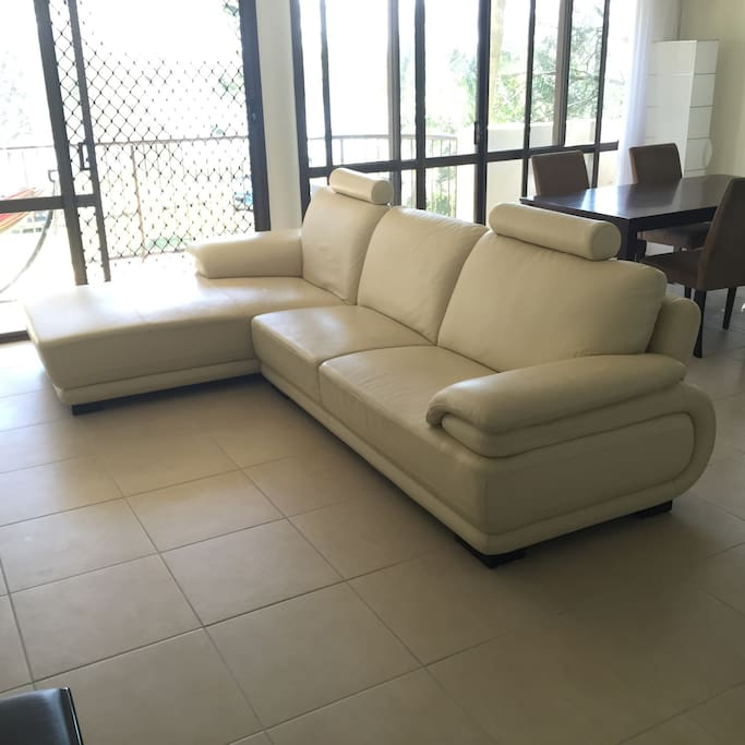 Super comfortable leather couch and 4 seat dining table