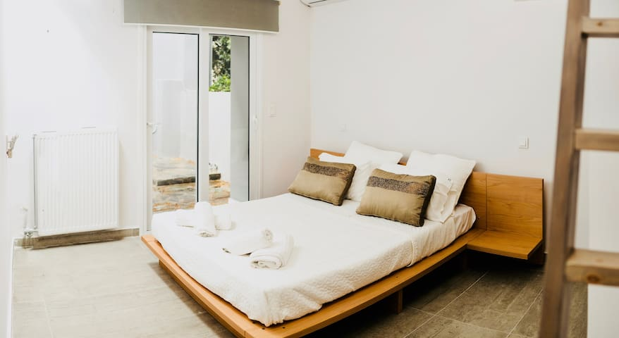 Bedroom with double bed and a small loft bed