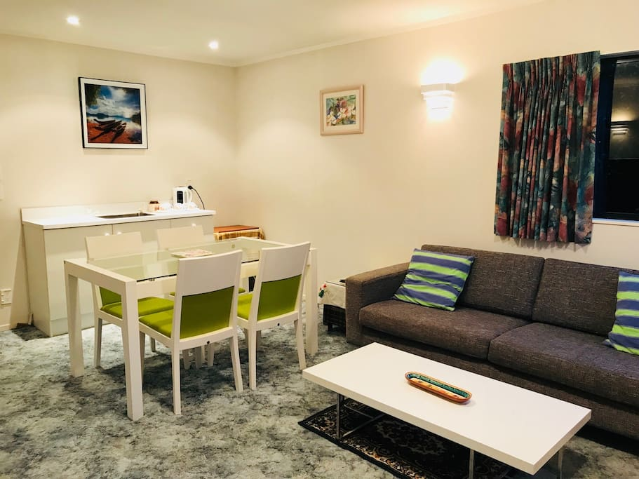 table and couch in the studio apartment