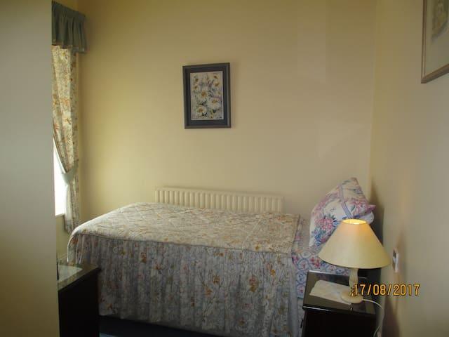 Single room with spacious bathroom, T.V. and wardrobe