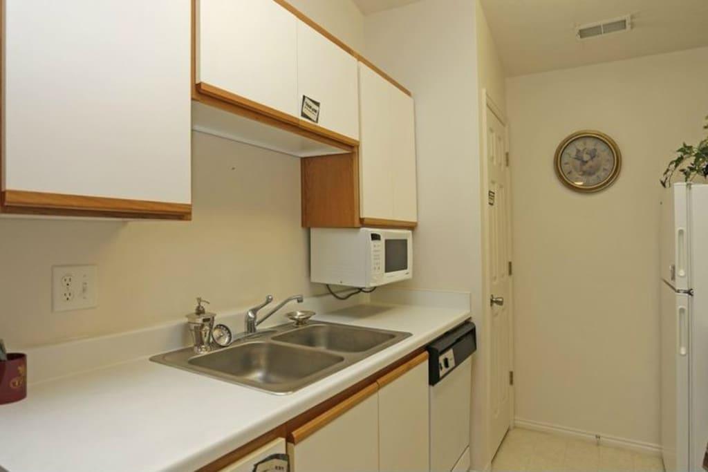 Kitchen with microwave, dishwasher, stove, and fridge.