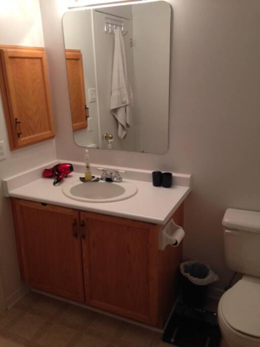 Four piece bathroom with hair dryer.