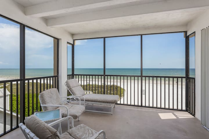 Charming oceanfront condo with views and shared heated pool!